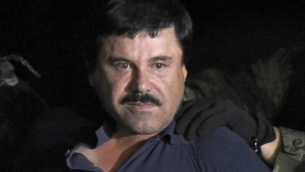 "Joaquin ""El Chapo"" Guzman escorted into a helicopter at Mexico City's airport following his recapture in Los Mochis, in Sinaloa State. 8 Jan 2016"