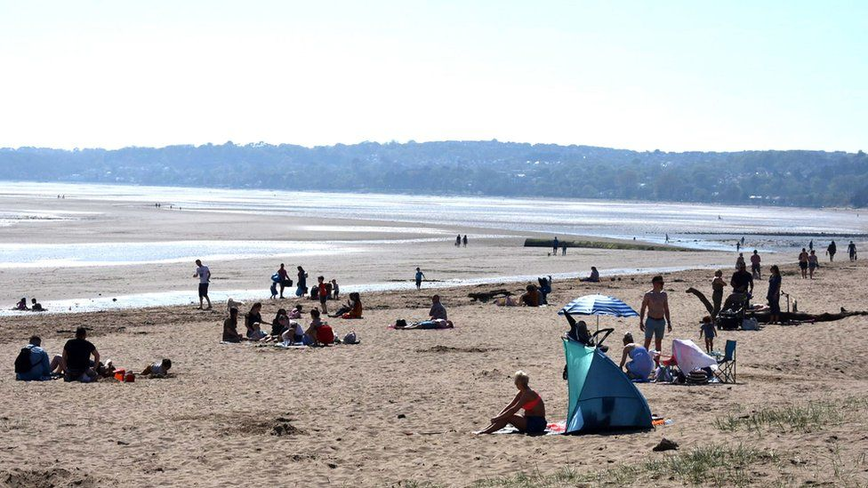 Sunbathers in Swansea Bay