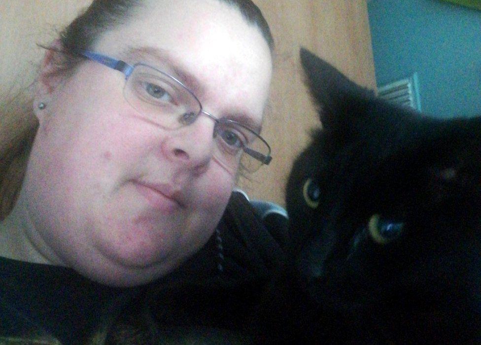 Sam Copeland-Whelan with her cat Misty