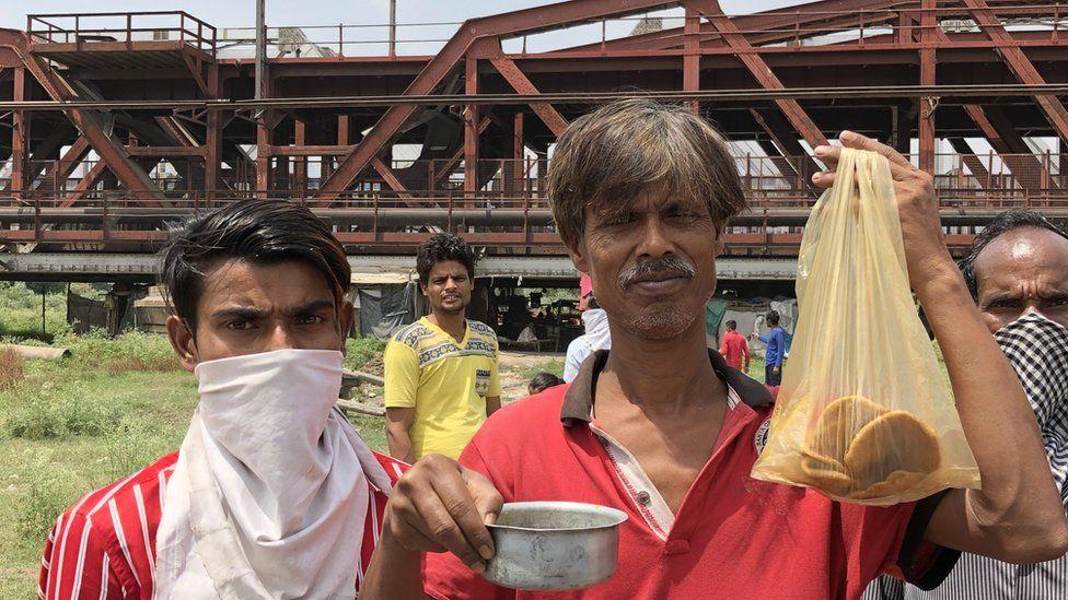 Rickshaw puller Sarathi Sarkar lives in a shanty under a river bridge in Delhi