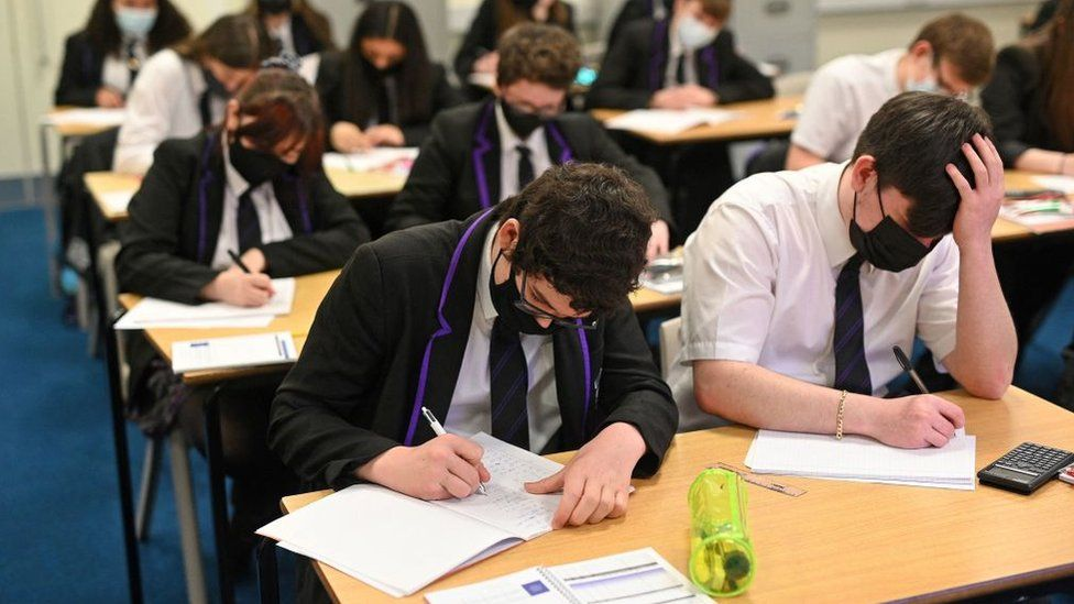 Secondary school pupils in face masks in class