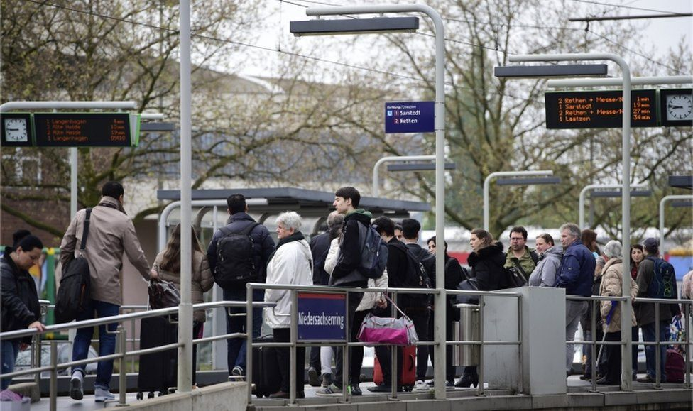 Residents wait for the tram as part of the evacuation of 50,000 people on May 7, 2017 in Hanover, Germany.