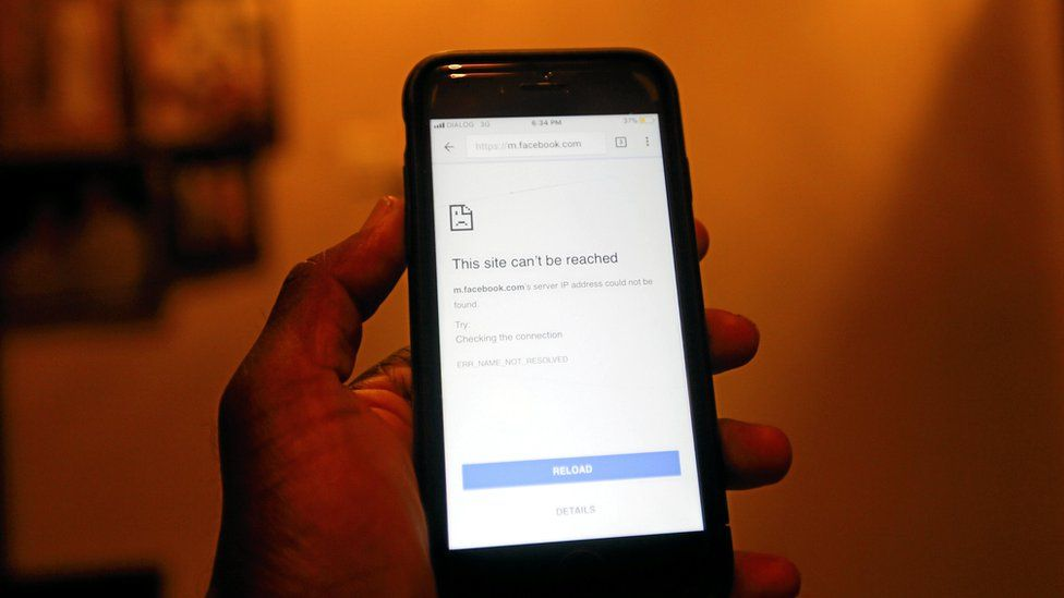 A mobile phone screen shows a Facebook page unable to open after the government shut down social messaging networks including Facebook island wide in Colombo, Sri Lanka on 7 March 2018