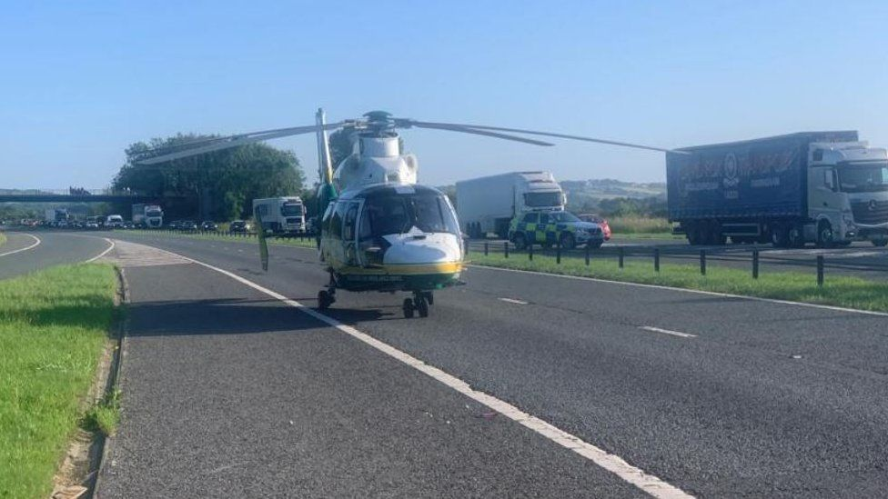 Air ambulance on motorway