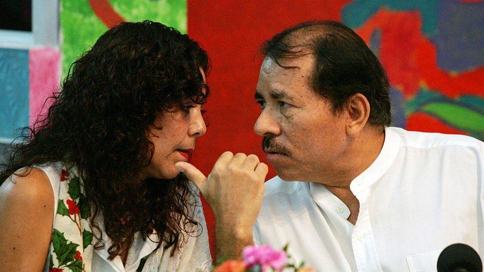 Rosario Murillo talks closely to the president of Nicaragua, Daniel Ortega