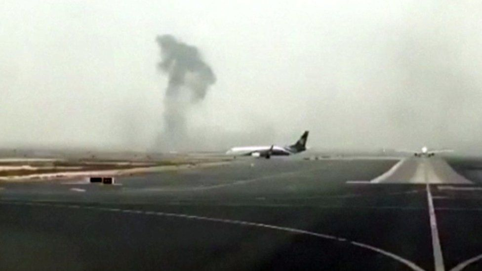 This image made from video shows smoke rising after an Emirates flight crash landed at Dubai International Airport on Wednesday, 3 Aug 2016.