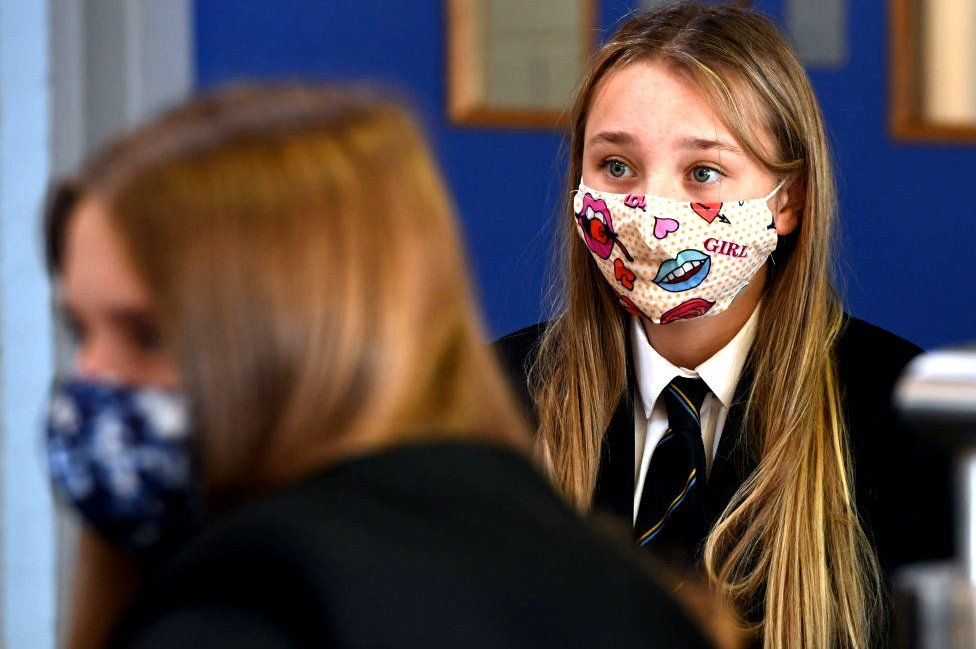 Pupil wearing mask in classroom