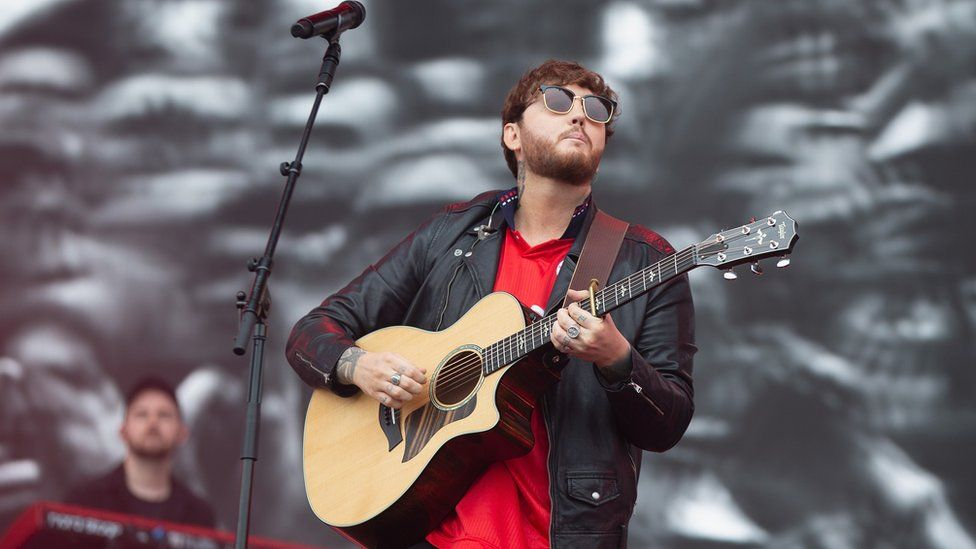 James Arthur playing guitar