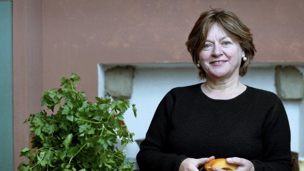 BBC Radio 4 presenter Sheila Dillon standing in a kitchen