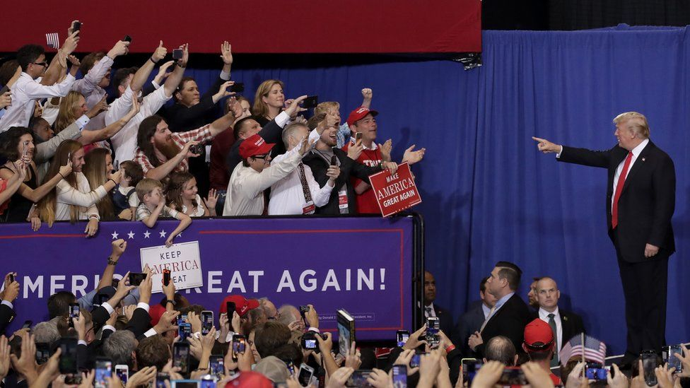 Donald Trump points to supporters in Nashville.