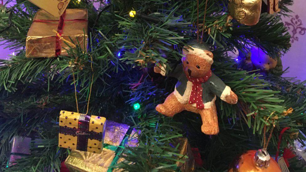 Teddy bear ornament on Christmas tree