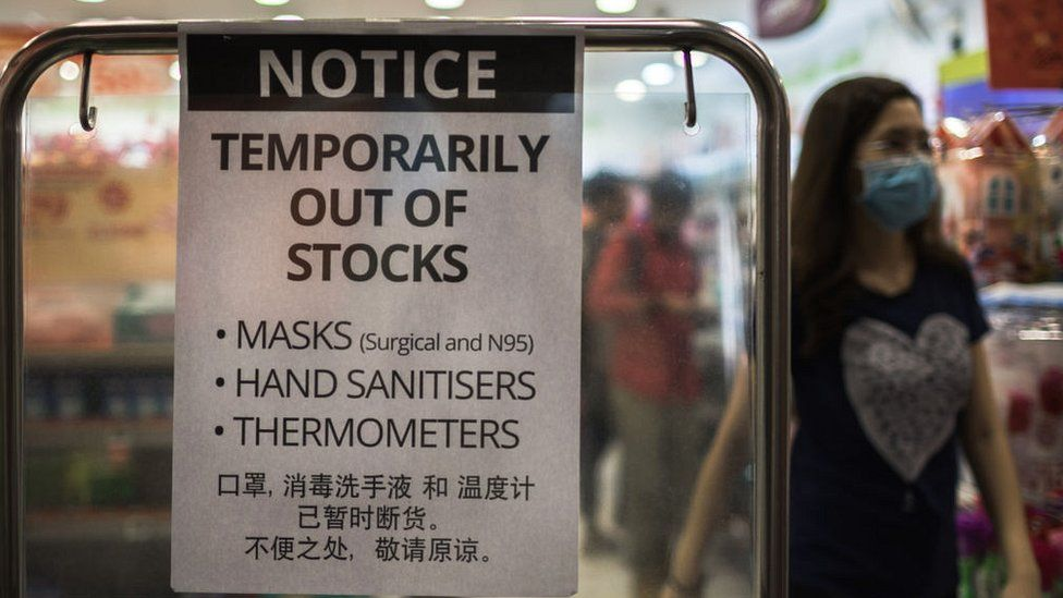 Pharmacy sign in Singapore saying masks out of stock