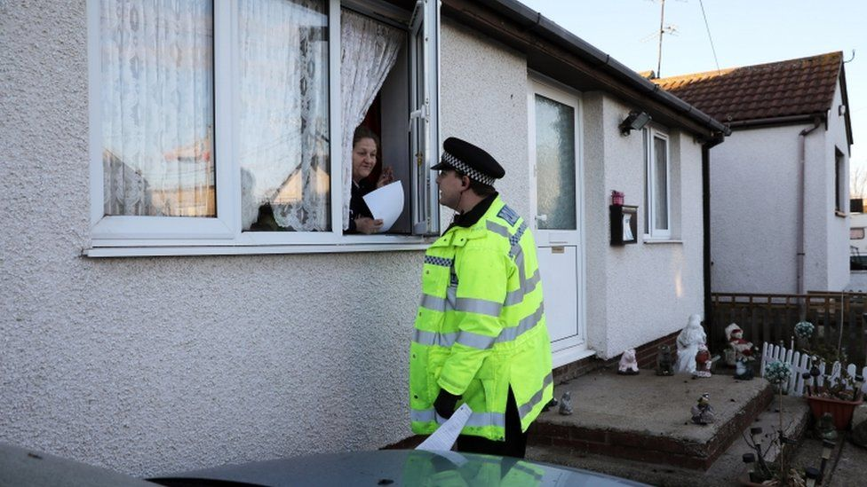Police officer talks to resident