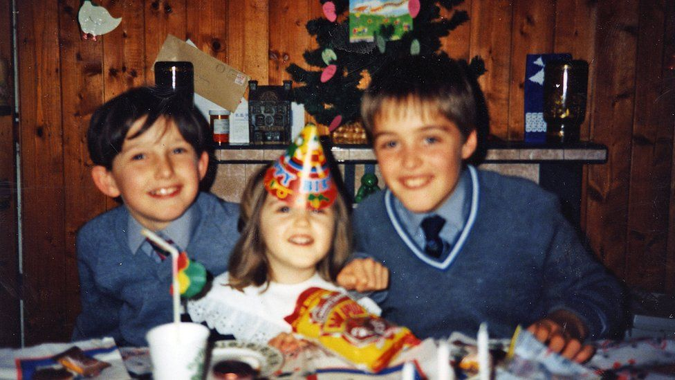 A young Jonathan Spollen (left) and his cousins in birthday hats