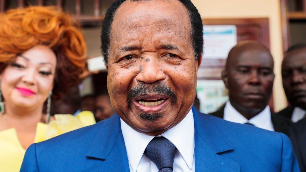 Cameroon's President and head of Cameroon People's Democratic Movement Paul Biya speaks to media after casting his vote at a polling station during presidential elections in Yaounde, Cameroon on October 07, 2018.