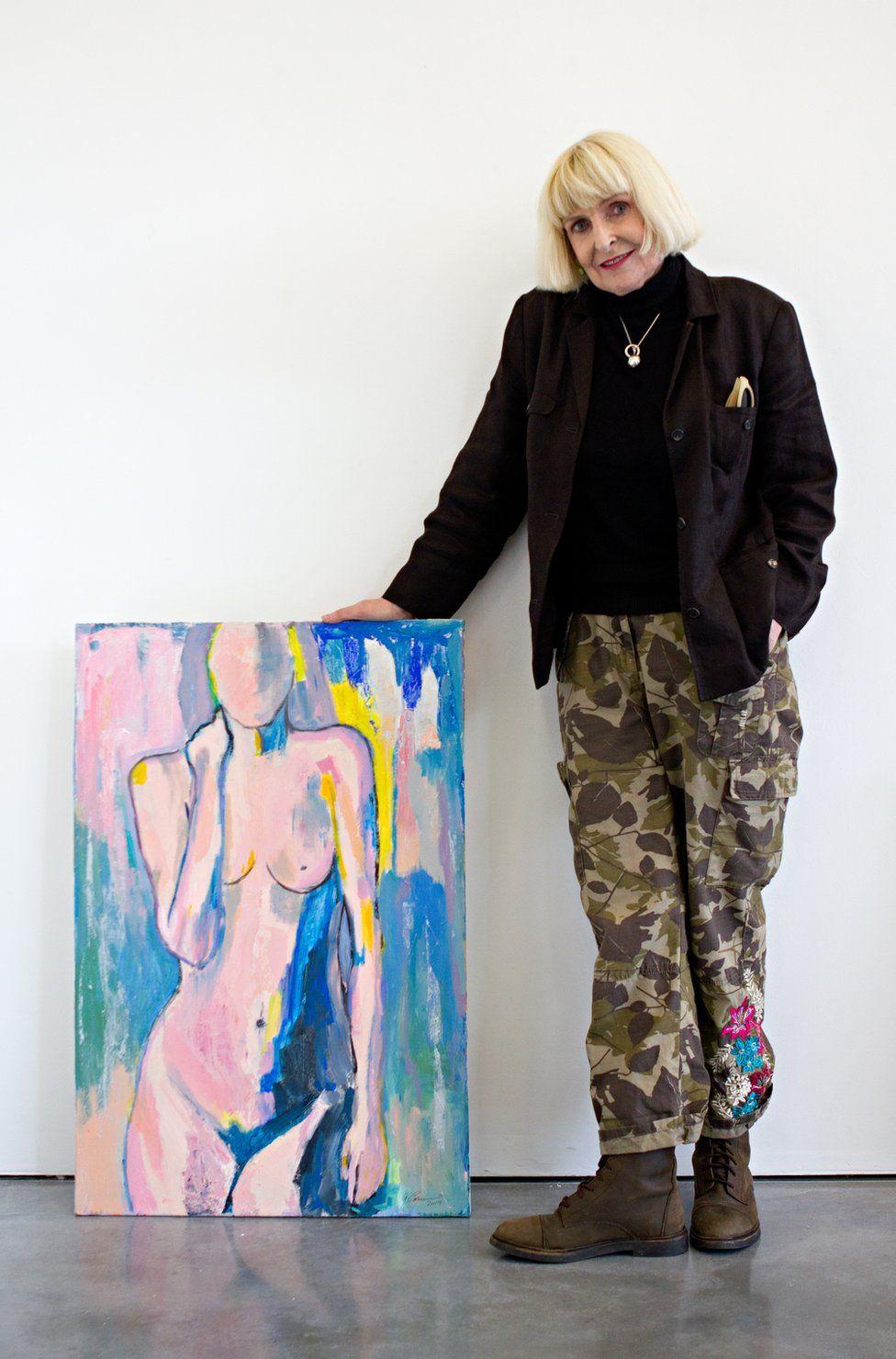 Geraldine Crimmins standing next to her artwork