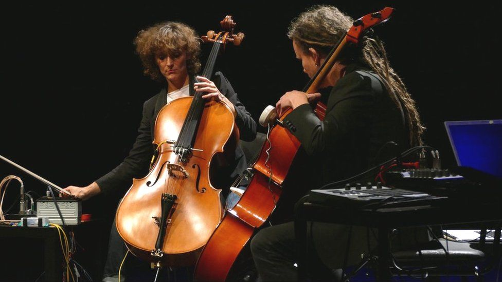 Dr Alice Eldridge (l) and Dr Chris Kiefer (r) of the University of Sussex play their self-resonating feedback cellos at the EarZoom Festival 2017, Ljubliana
