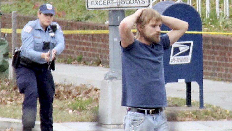 Edgar Maddison Welch, 28., surrenders to police on Sunday