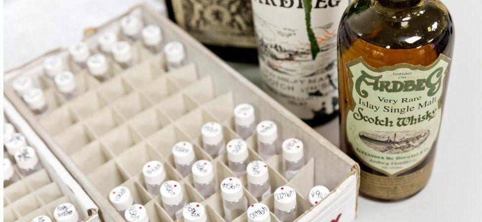 Scotch whisky bottles at Suerc laboratory