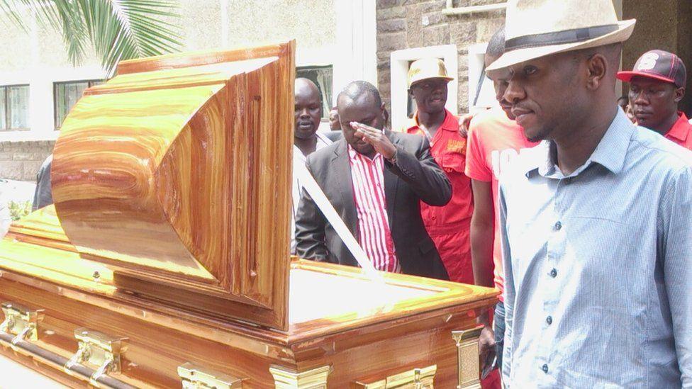 "Colleagues viewing the body of ""Mzee Ojwang"" at Nyayo Stadium, Nairobi, Kenya"