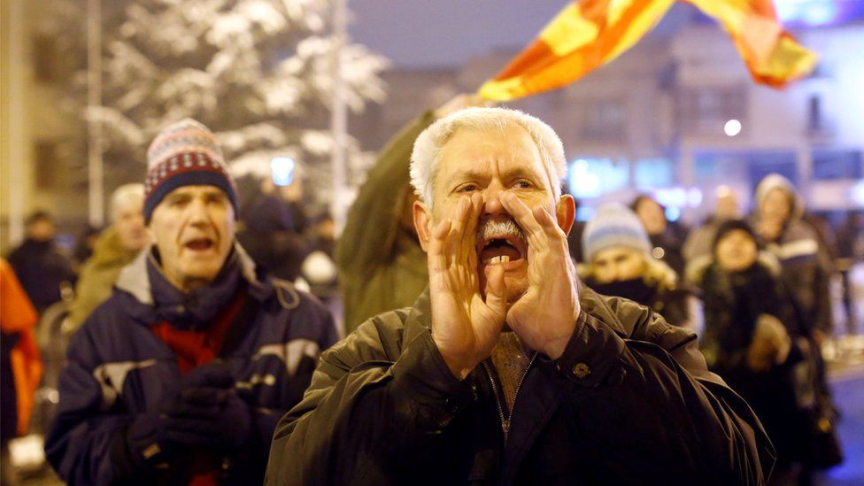Opponents to the name change protest outside the parliament in the capital, Skopje