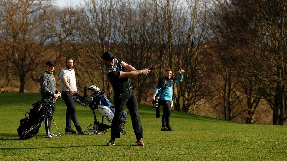 Golfers play at Hartford Golf Club