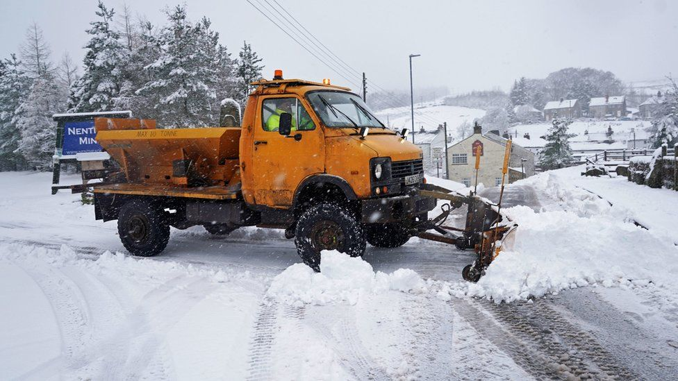 A snow plough works on the roads in Nenthead, Cumbria