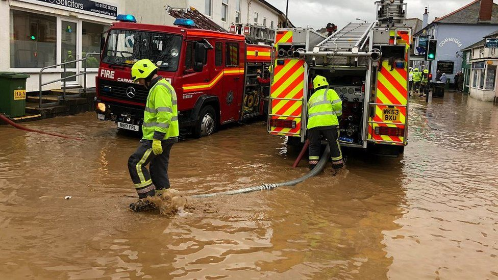 Fire crews pumping water out of the roads in Hayle
