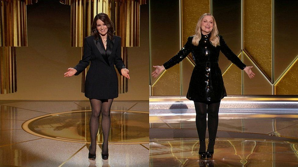 Hosts Tina Fey (L) and Amy Poehler
