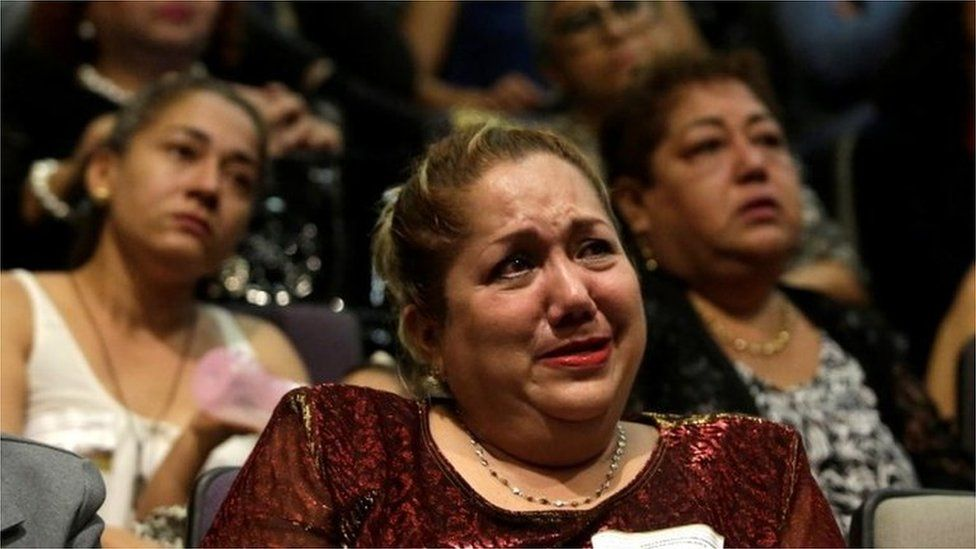 Relative of five youths killed in 2016 reacts during a public apology by the Veracruz state government, in Mexico City, Mexico March 4, 2019