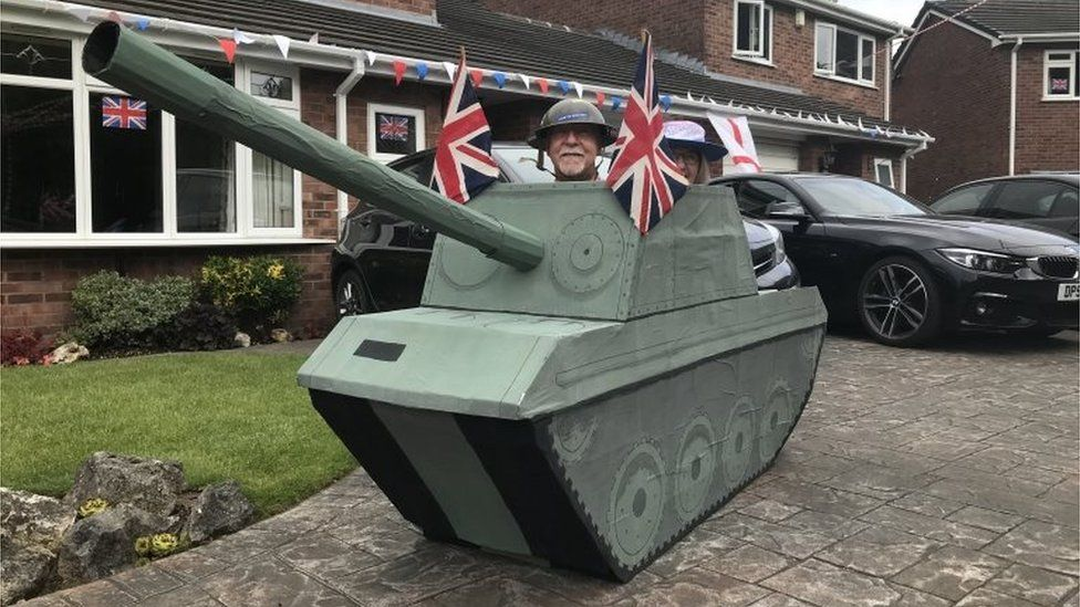 Residents of Portola Close in Grappenhall, Cheshire, celebrate VE Day in a model tank on 8 May 2020