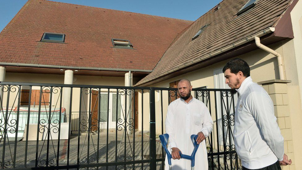 Abdallah Benali (L), president of the association Generation 2000 Mosque of Luce, and Vice President Karim Benaya, talk in front of the Mosque of Luce, on 15 November 2015.