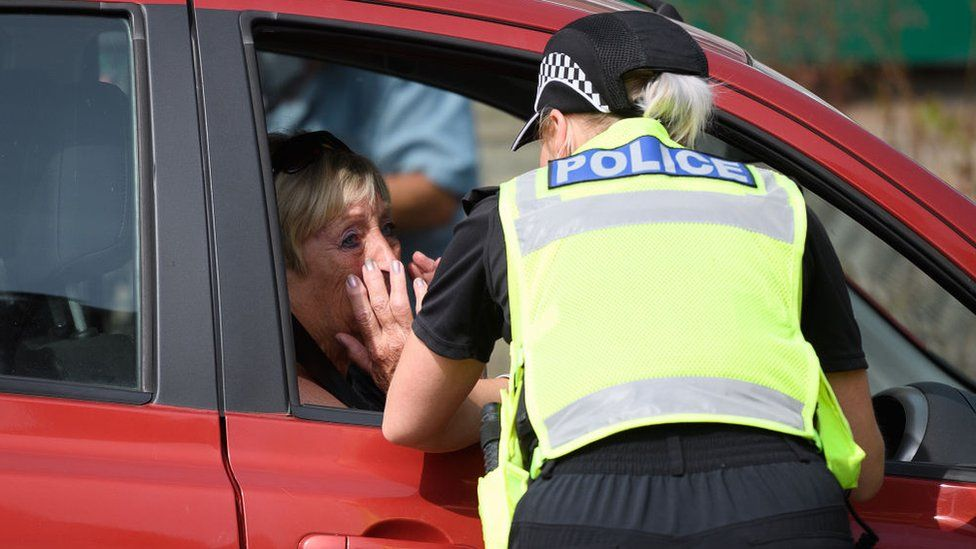 Tearful resident with police