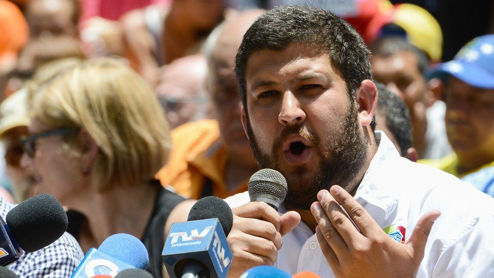David Smolansky speaks next to other opposition mayors during a press conference at Bolivar square in the Chacao neighbourhood in Caracas, on May 25, 2017