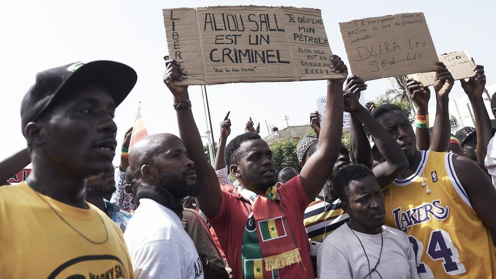Demonstrators gather during a protest against President Macky Sall
