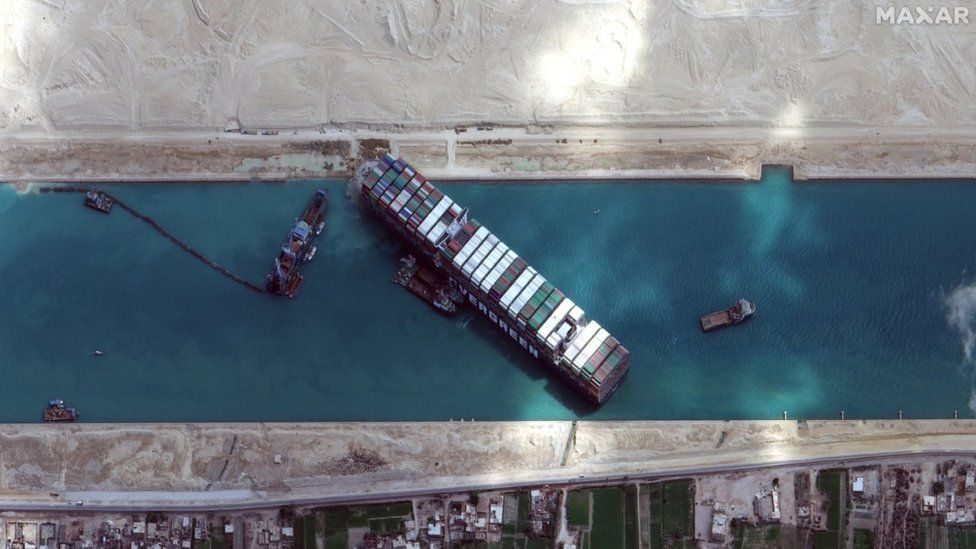 A handout satellite image made available by Maxar Technologies shows the excavation and dredging operations around the Ever Given on 28 March 2021