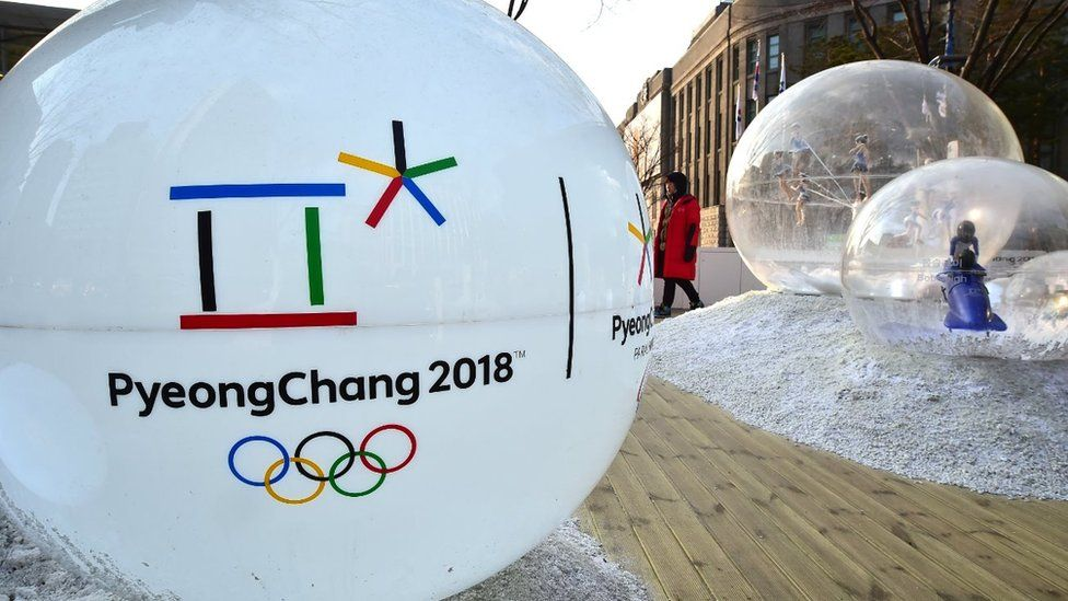 The emblem of the 2018 PyeongChang Winter Olympics, with a capital 'C', is seen on an advertisement ball outside the city hall in Seoul on January 26, 2016