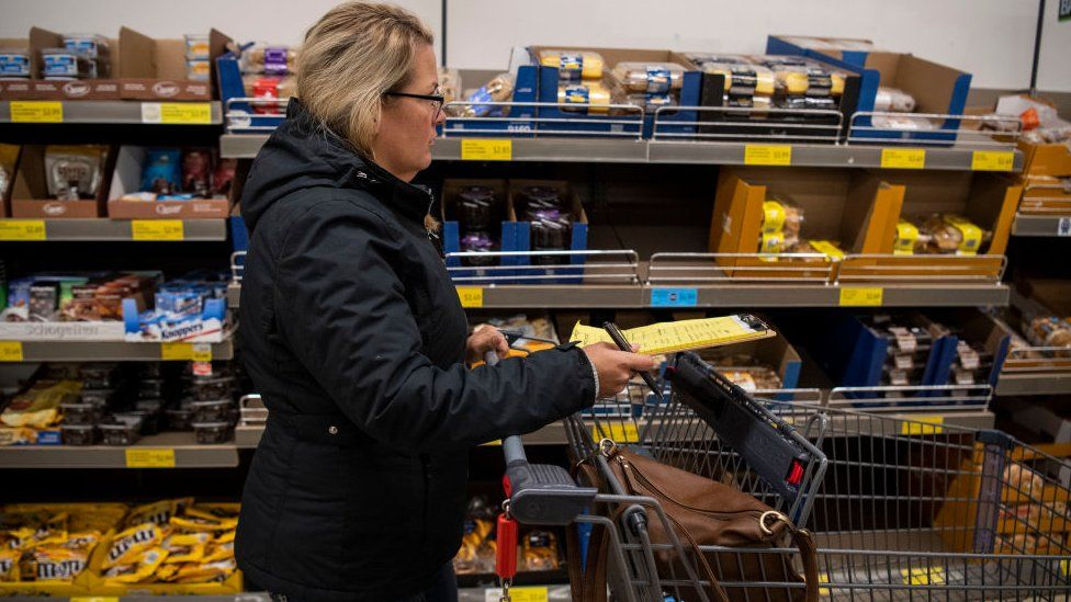 A woman shops for groceries
