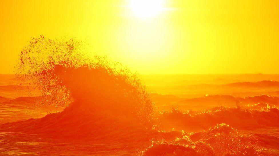 Sea breaks under sun