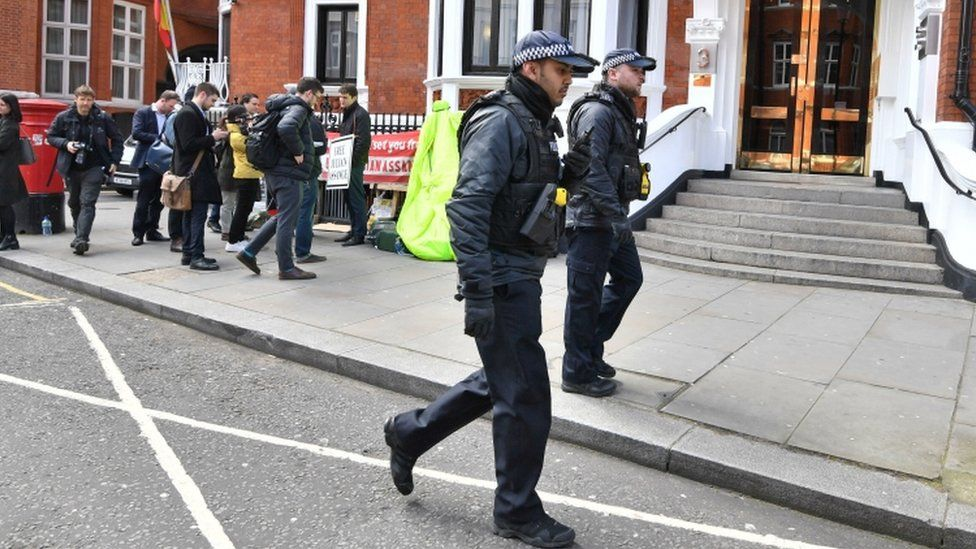 Police officers outside the Ecuadorean Embassy
