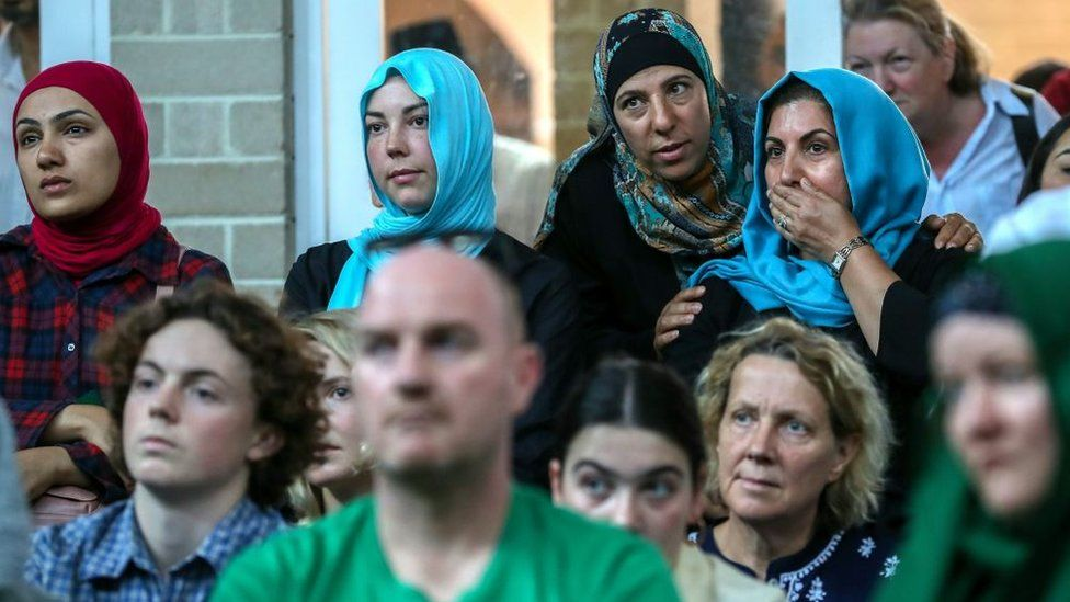 Muslim women stand among other mourners of different faith at a mosque service in Melbourne dedicated to the Christchurch victims.