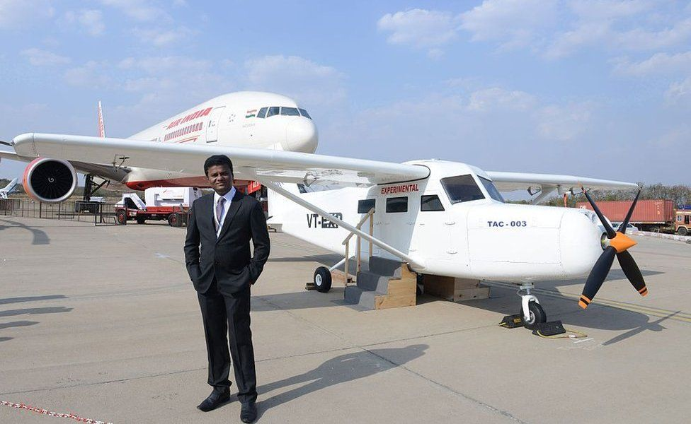 Indian pilot Captain Amol Shivaji Yadav poses beside his self- constructed TAC-003 aircraft at The India Aviation 2016 airshow at Begumpet Airport in Hyderabad on March 16, 2016. Yadav, a pilot with Jet Airways, has manufactured the aircraft which has been certified by Hindustan Aeronautics Limited (HAL), at his home in the western Indian city of Mumbai. The fifth edition of India Aviation, a five day event scheduled to run from March 16-20, more than 200 exhibitors from 12 countries.