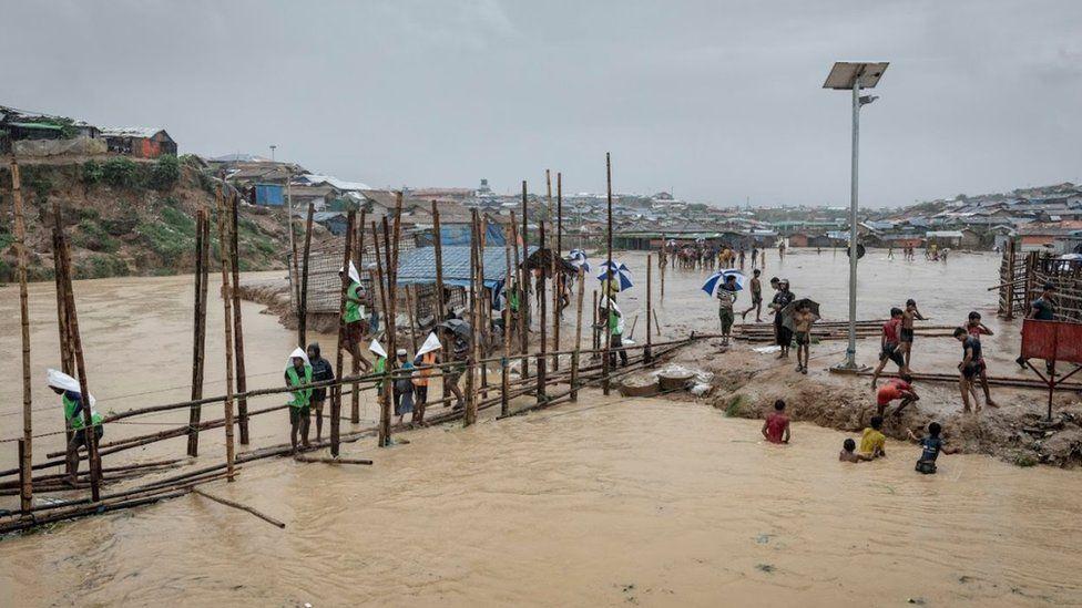Bamboo bridge across flooded river