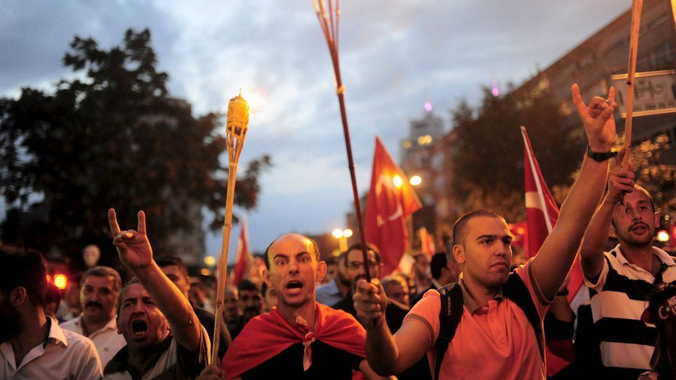 Nationalist groups shout slogans during a protest in Istanbul, Turkey, 8 September 2015