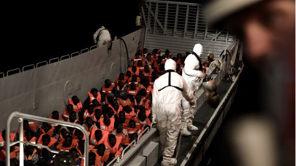 Migrants are rescued by staff members of the MV Aquarius, a search and rescue ship run in partnership between SOS Mediterranee and Medecins Sans Frontieres in the central Mediterranean Sea, June 10, 2018.