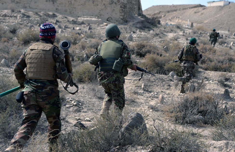 In this photograph taken on February 17, 2016, Afghan security forces patrol following an operation against Islamic State (IS) militants in Achin district in Nangarhar province.