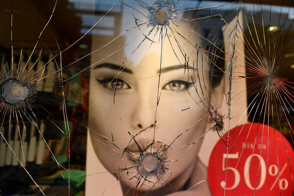 The display window of a fashion shop is severely damaged during the G20 summit in Hamburg, 7 July