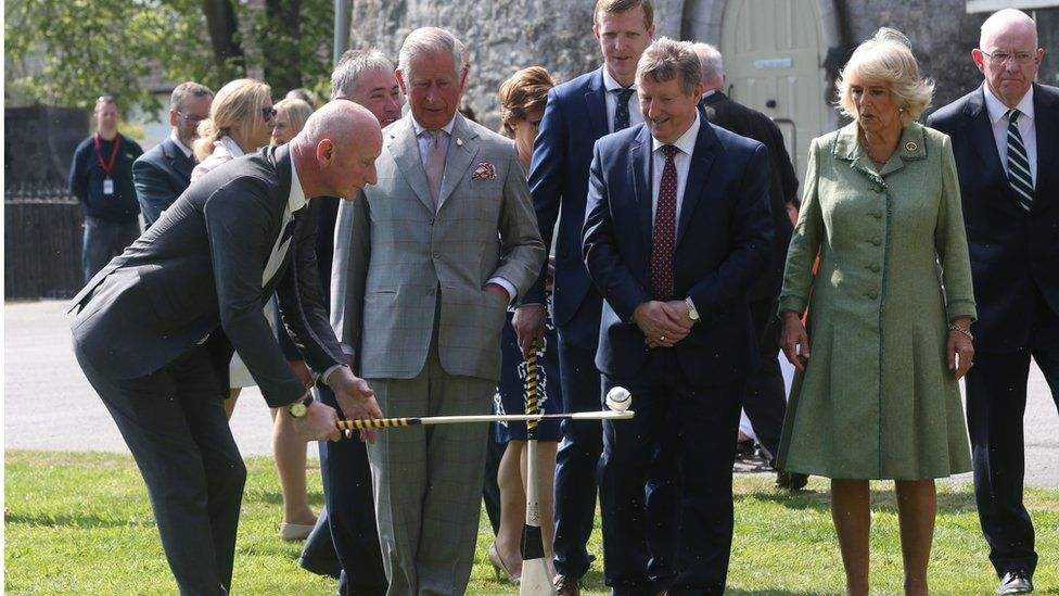 Prince Charles watching a hurling demonstration at Kilkenny Castle