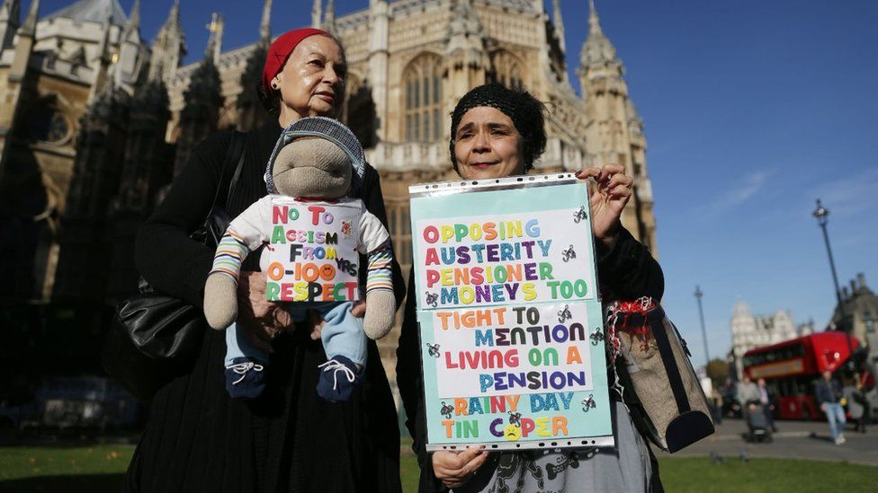 Two women protesting against proposed pension changes