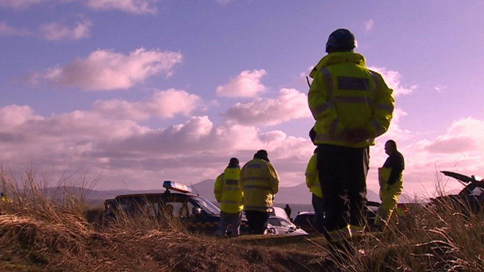 Police at Malltraeth, Anglesey, after two men's bodied were discovered